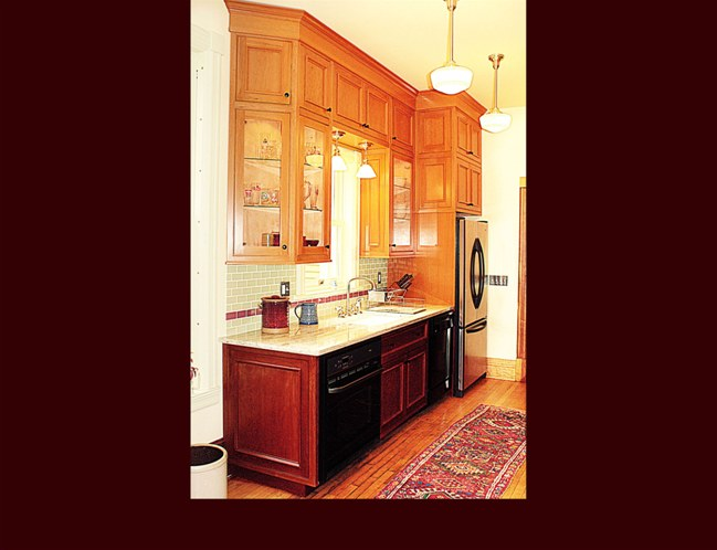 Cherry Kitchen Cabinetry. Flat panel door style with applied moulding.