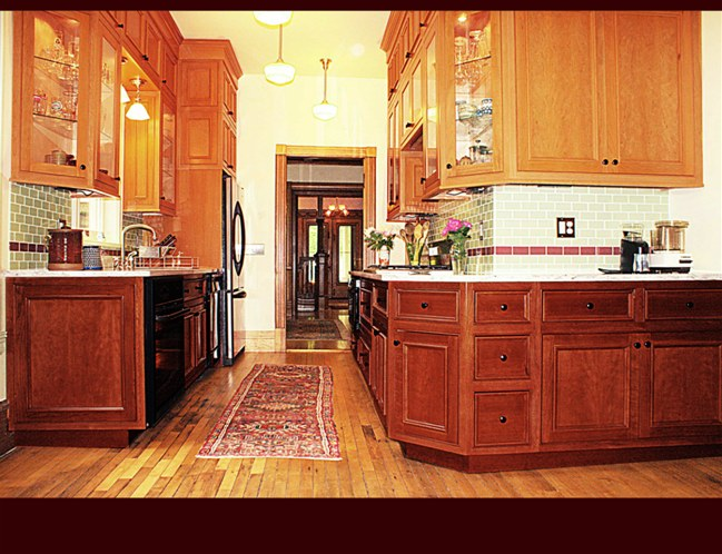 Cherry Kitchen Cabinets. Lower cabinets stained 'Traditional Cherry'. Upper Cabinets are 'Natural Stain'.
