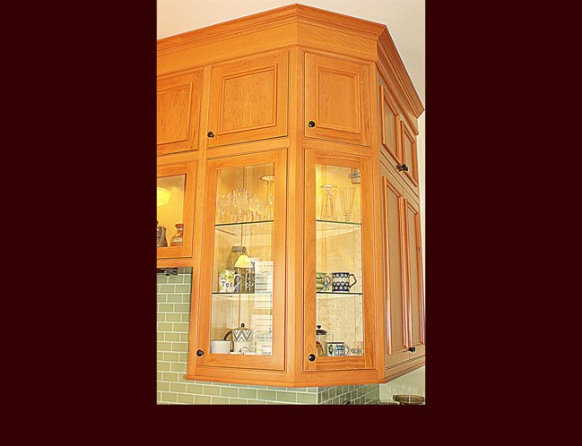 Cherry Kitchen Cabinets. Two tiered upper wall cabinets. 10' ceiling height.