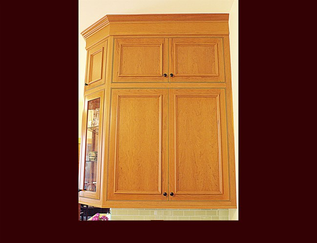 Cherry Kitchen Cabinetry. Four piece custom crown molding.