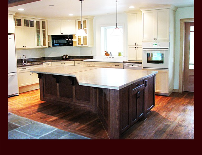 Custom Stained Walnut Kitchen Island. Flat Panel full overlay door style.