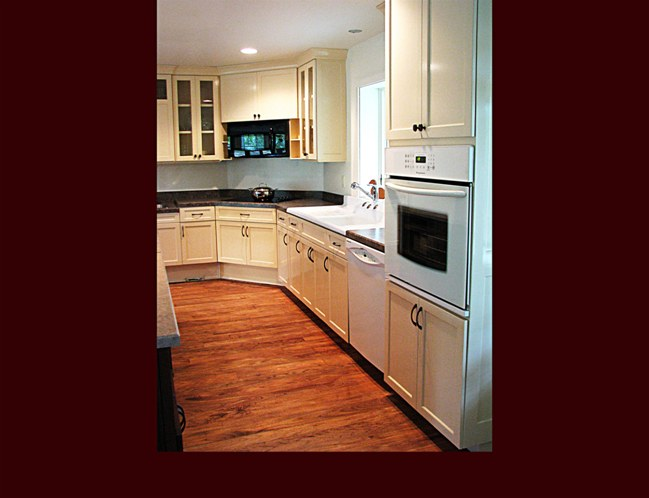 Painted Custom Maple Kitchen cabinets. Flat Panel door style with laminated countertops.