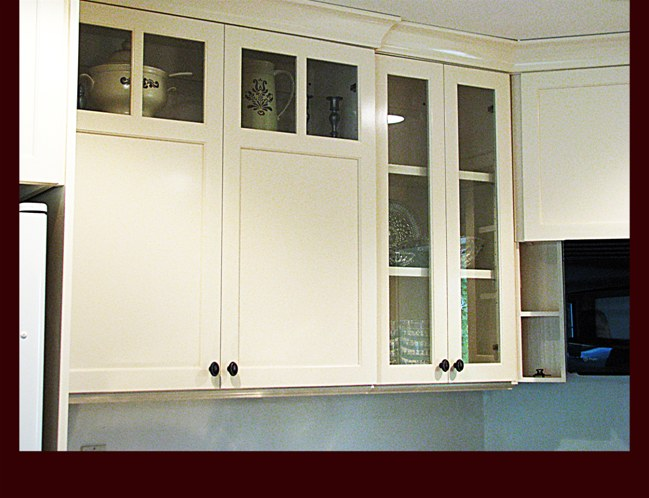 Custom glass door styles on upper cabinetry.