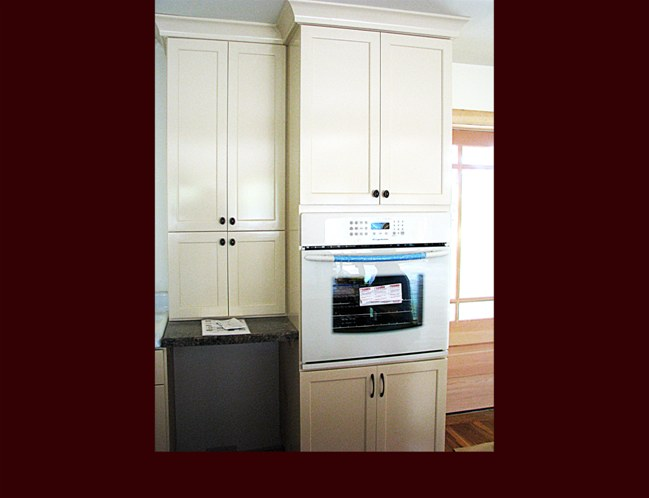 Full height oven appliance cabinet with pantry storage. Tall upper pantry cabinet over dishwasher.