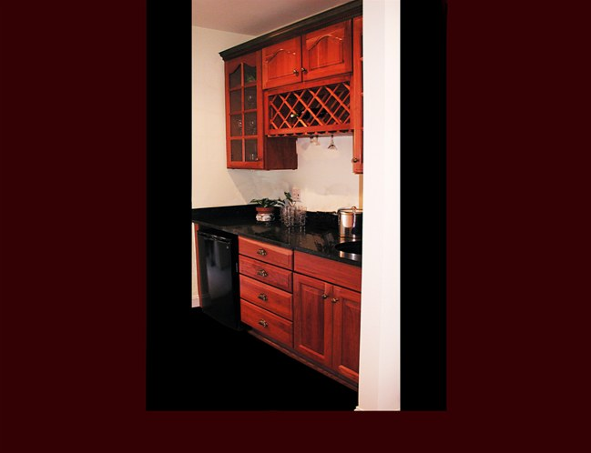 Cherry Butler's Pantry Cabinetry. Raised Panel door style. Cathedral door style on upper cabinets. Wine Rack with wine glass rack.