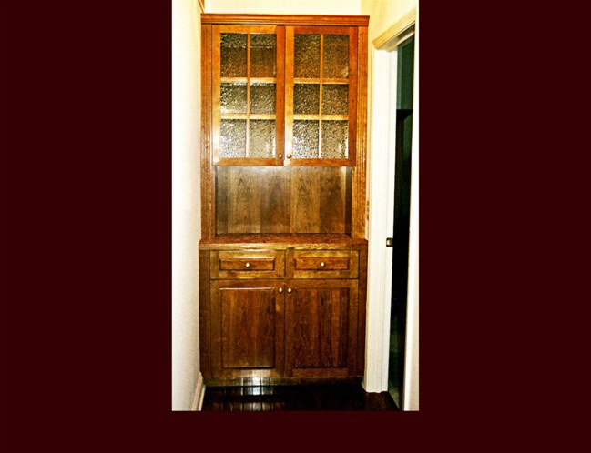 Cherry Butler's Pantry Cabinet. Raised Panel door style. Antique Glass doors in wall cabinets.